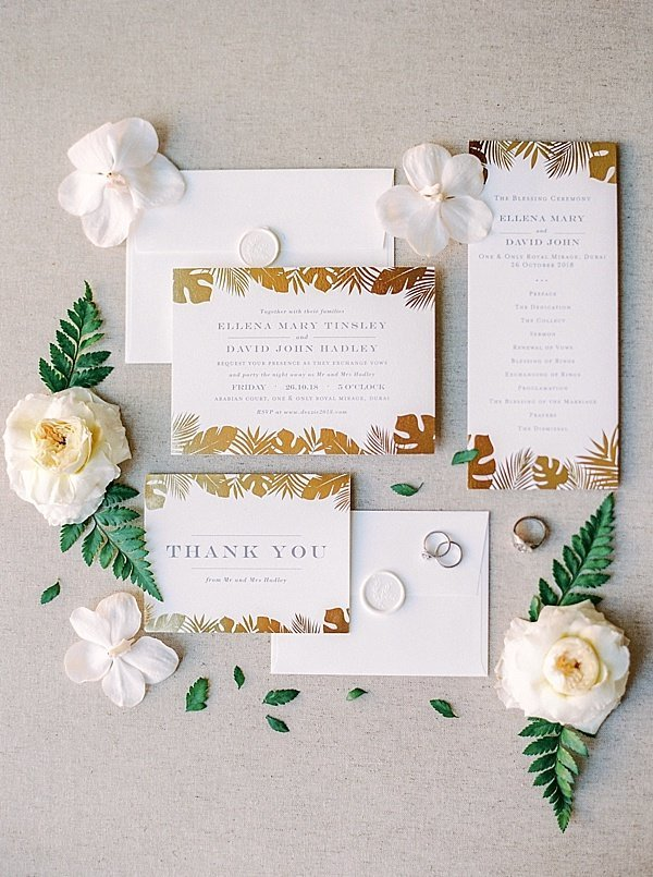 Gold and white invitation suite dubai wedding