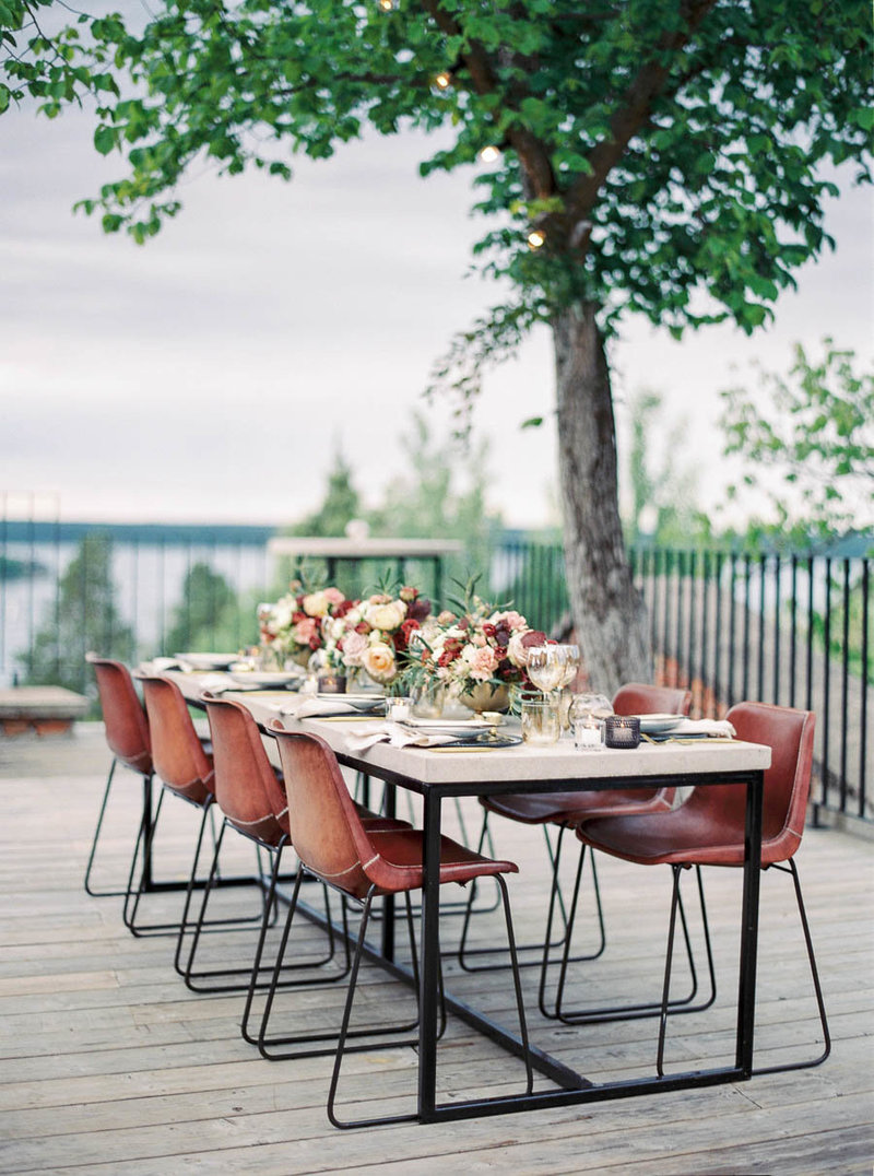 Modern outdoor table setting for for wedding dinner at ruin retreat