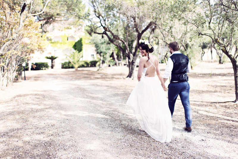 Bride and Groom walk in the Vineyard in Santa Maria Italy