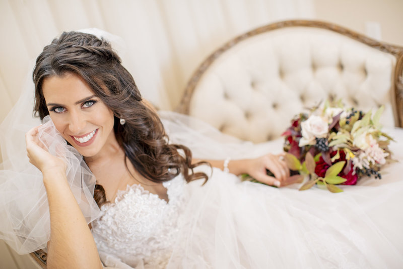 brides lays on old fashioned couch