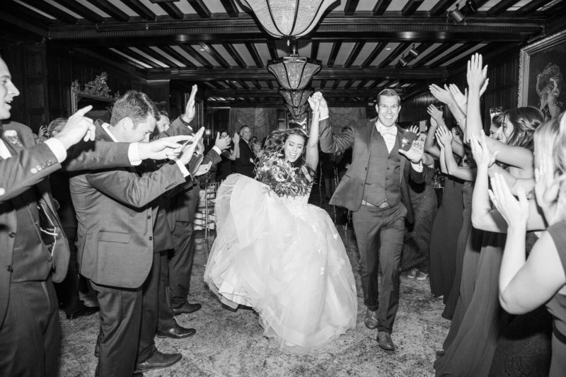 black and white bride and groom enter reception with dance