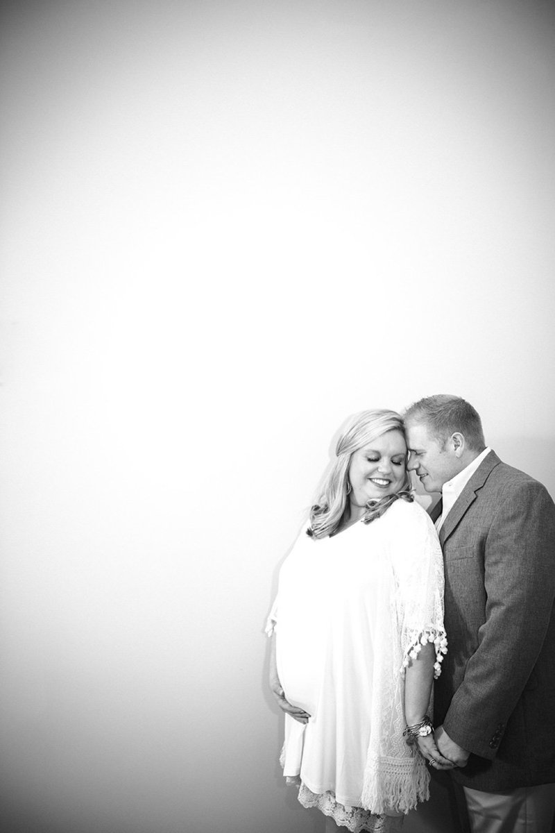 Black and white maternity photo against plane wall by Knoxville Wedding Photographer, Amanda May Photos.