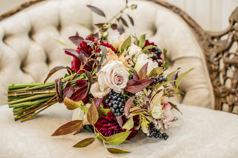 rustic bouquet sits on elegant chair