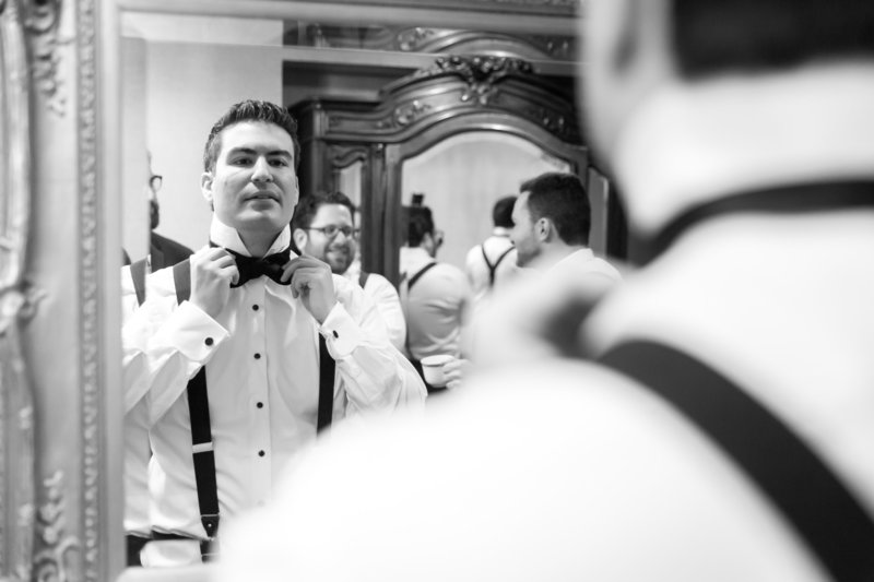 Documentary style groom prep photo