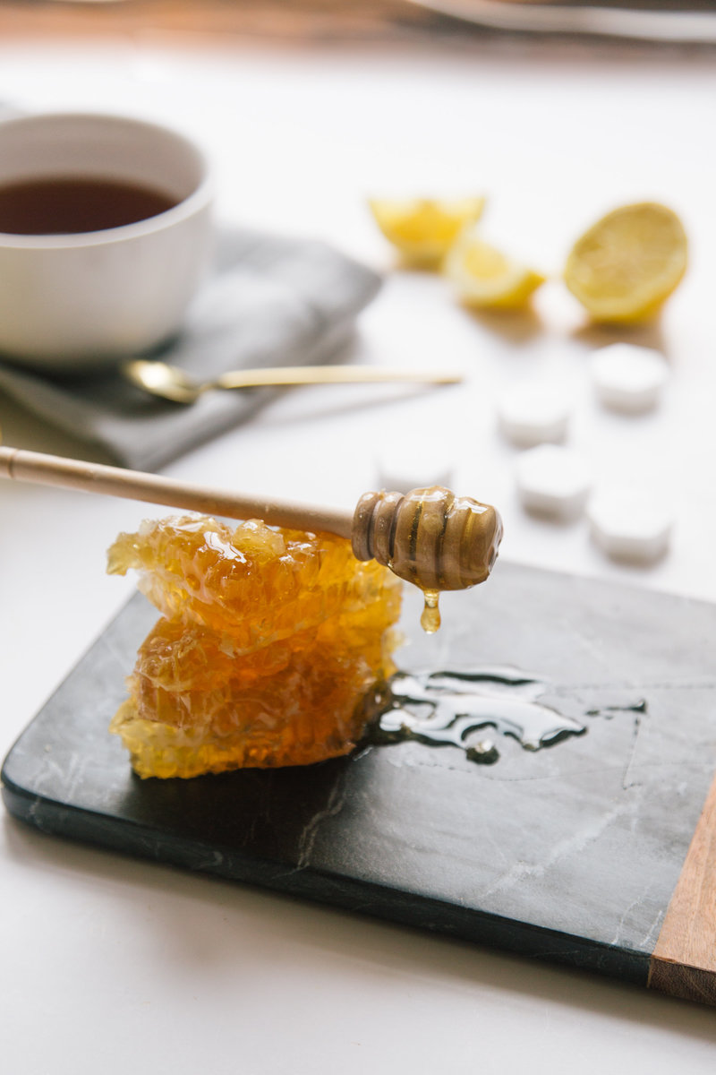 fresh honeycomb dripping onto slate tray