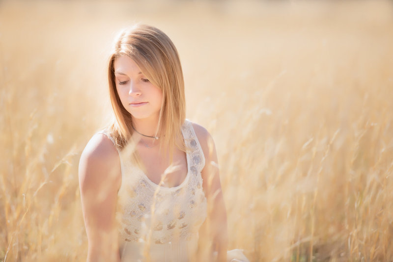 Huntsville Alabama senior portrait photographer beautiful girl sitting in grass  field pose