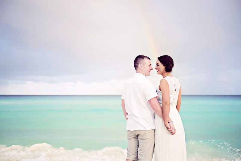 Couple have engagement session on the beach in Cancun Mexico Iberostar
