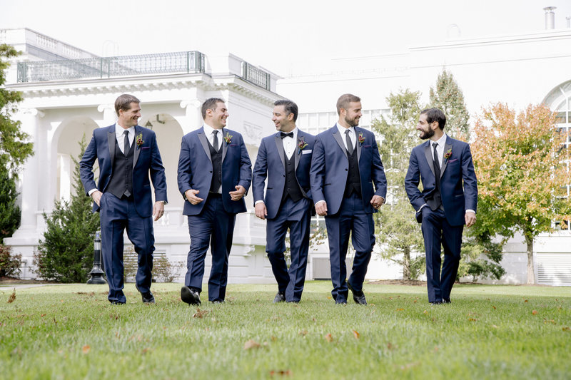 Groomsmen walking  and laughing at  Monmouth University