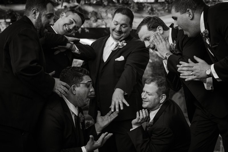 Wedding photo with the groomsmen. Posing to create a funny style of images