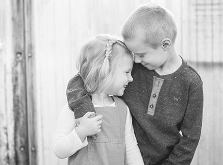 Brother and Sister hugging -  black and white children's photography