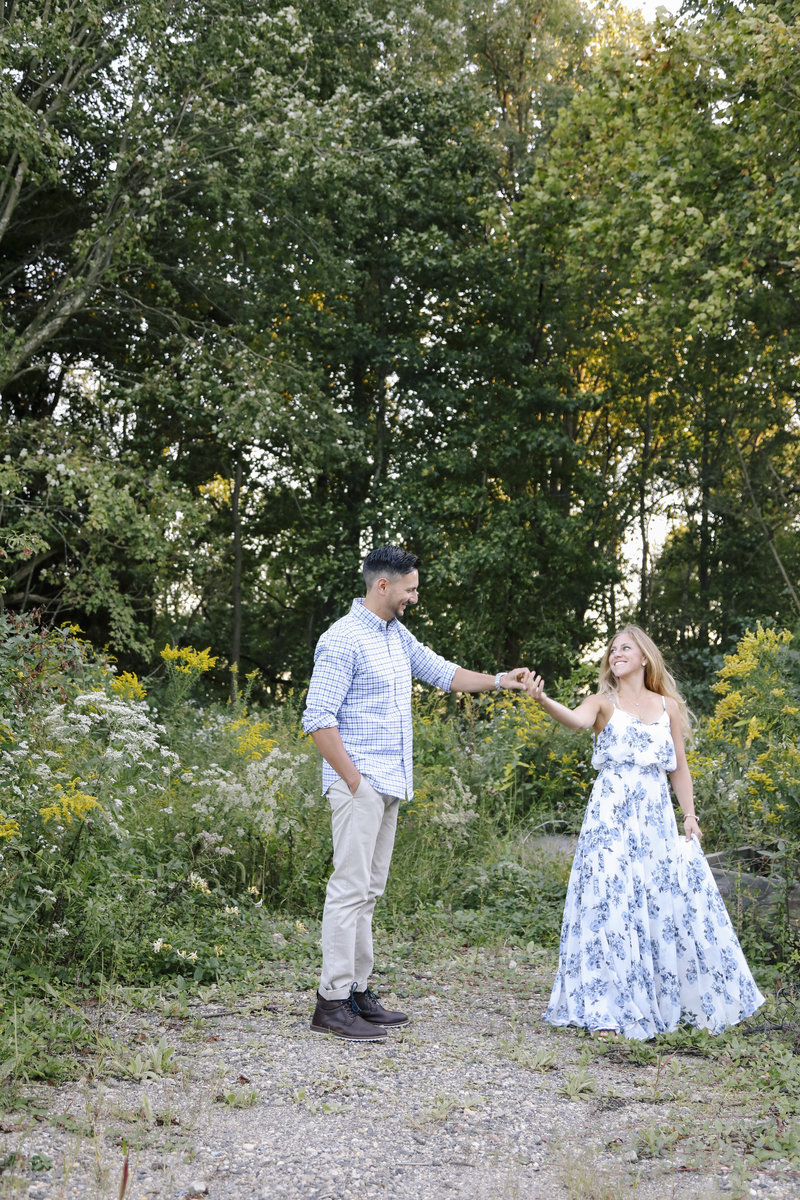 couple dancing in a field at winery