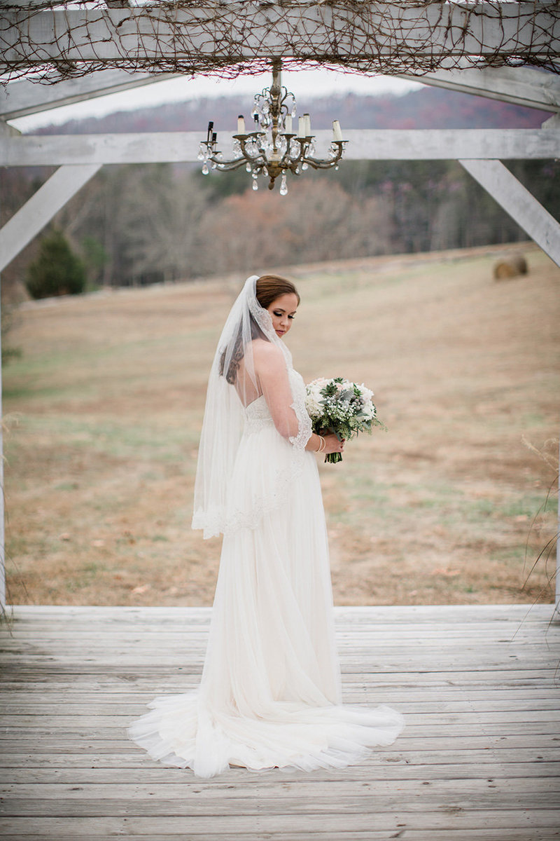 Standing under the pergula at Sampson's Hollow Wedding Venue by Knoxville Wedding Photographer, Amanda May Photos.