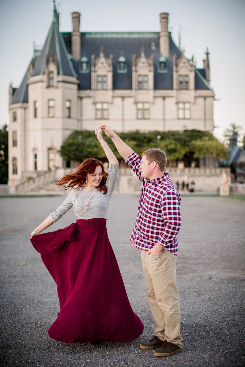 Twirling his bride at the Biltmore by Knoxville Wedding Photographer, Amanda May Photos.