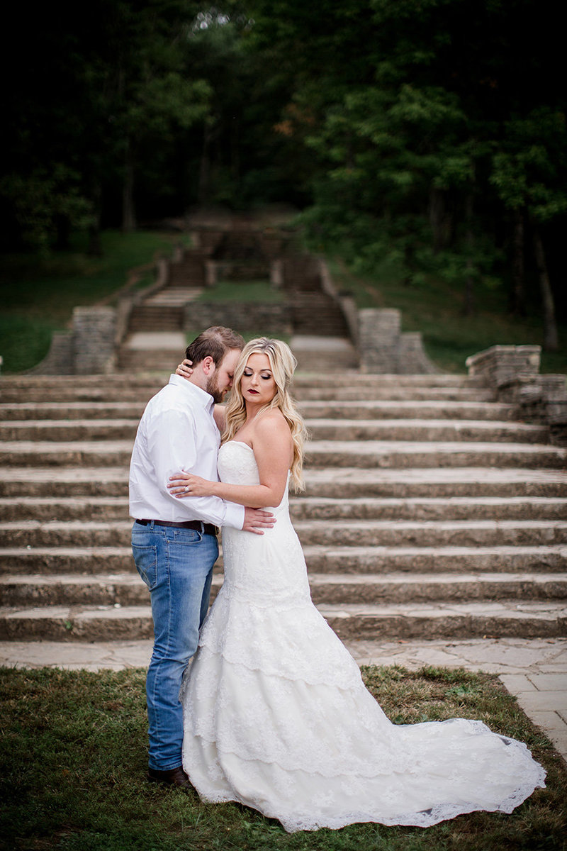 Groom leans his forehead into his bride in front of the steps at Percy Warner Park by Knoxville Wedding Photographer, Amanda May Photos.