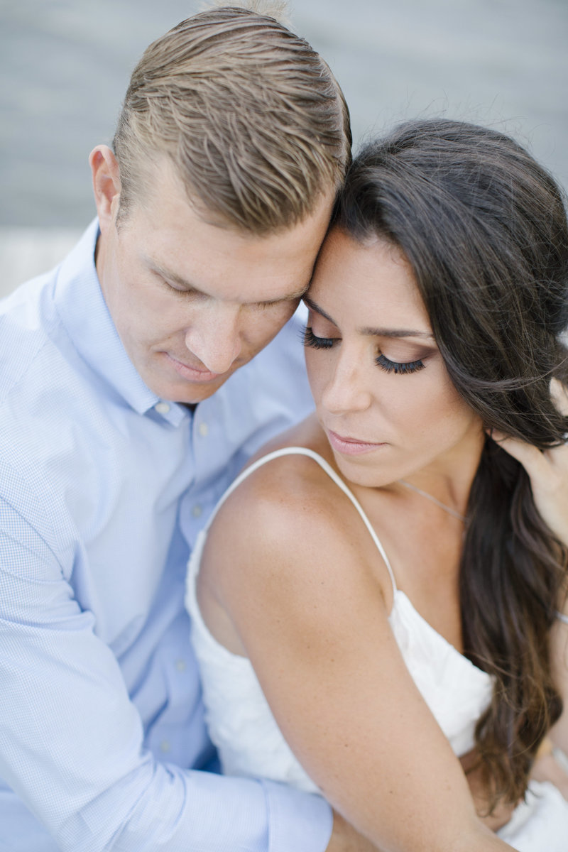 close up of couple with their eyes closed in sea bright engagement
