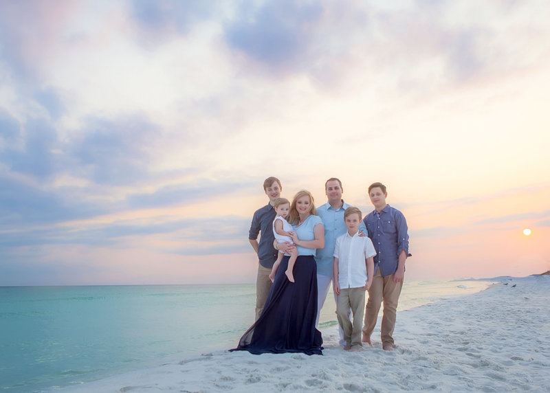 Large family with children standing for a photograph on the beach in destin florida