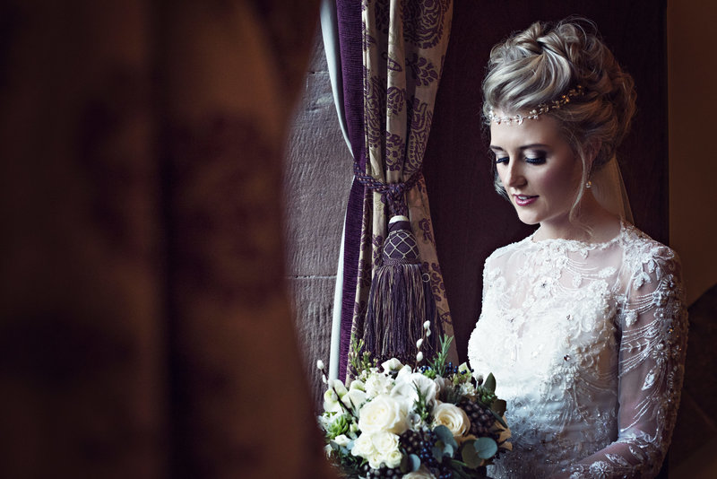 A bride before her wedding ceremony at Peckforton castle cheshire