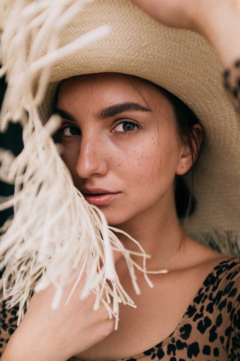 photo-of-woman-wearing-straw-hat-3597105