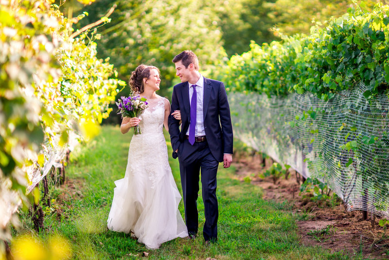couple walking in rocklands farm vineyard in Maryland
