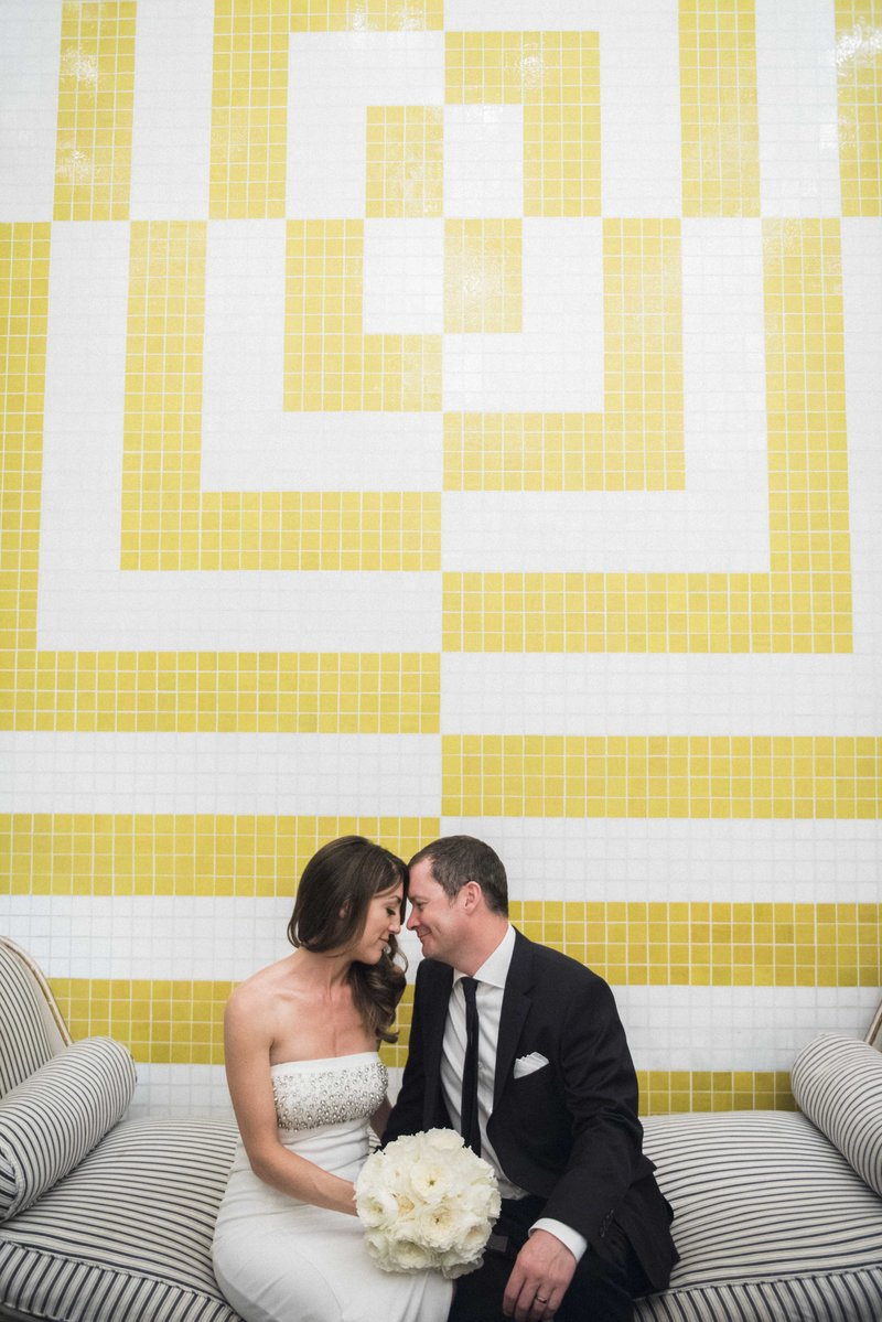 Married couple with yellow and white tile background