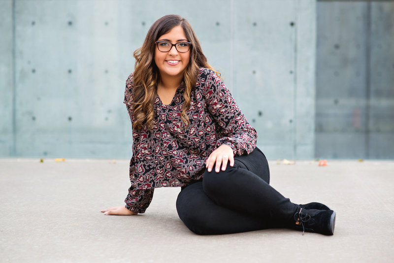 Coppell Band Member poses behind the Winspear Opera House and adjacent to Meyerson Symphony Center for senior pictures.