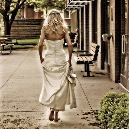 bride walk away, was so touched she raved and raved about her wedding photographers