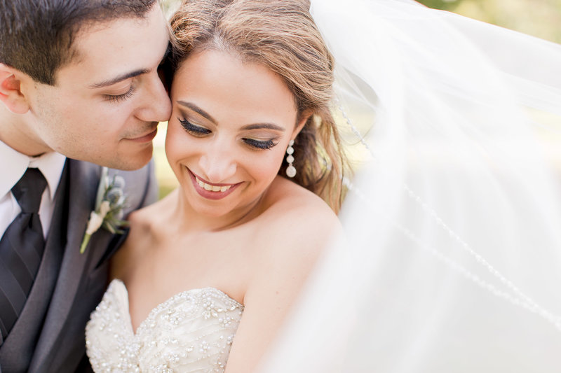 Groom kissing his bride on her cheek, a new jersey wedding photo