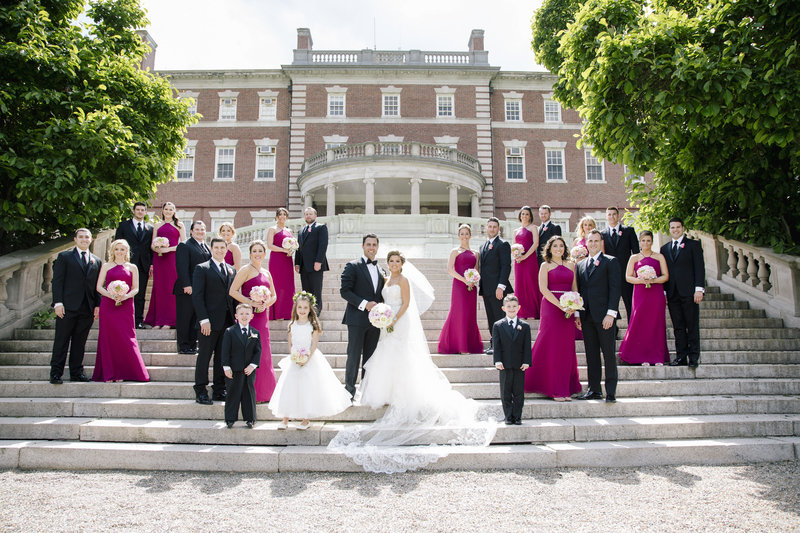 bridal party on grand staircase at fairleigh dickinson university