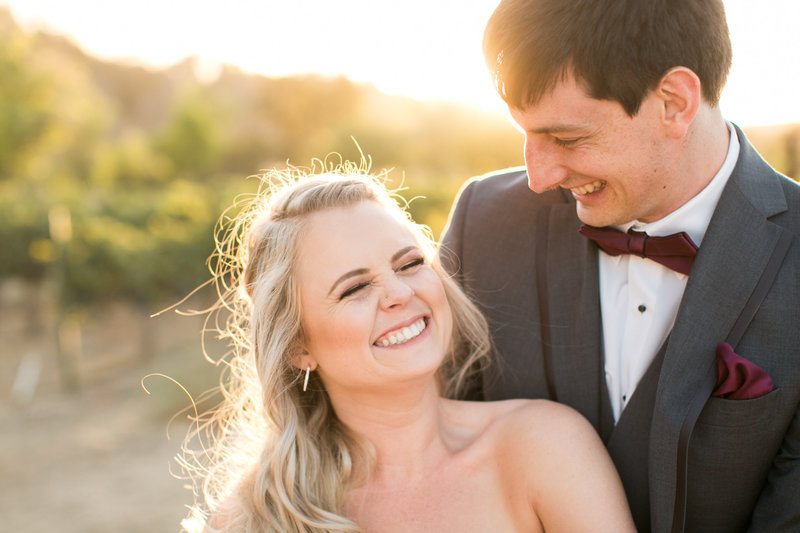 laughing couple at their wedding at Cass Winery in Paso Robles, Ca