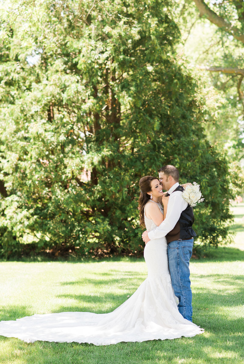 Iowa-outdoor-country-wedding-lace-cowboy-boots-denim-chic-Mississippi-Pearl-Photography