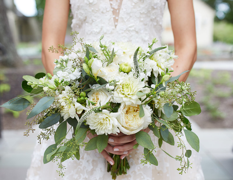 bride holding white flowers