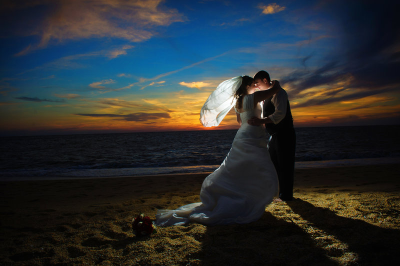 JandDstudio-wedding-rustic-vintage-brideandgroom-kissing-outdoor-sunset-beach-NJ-sand