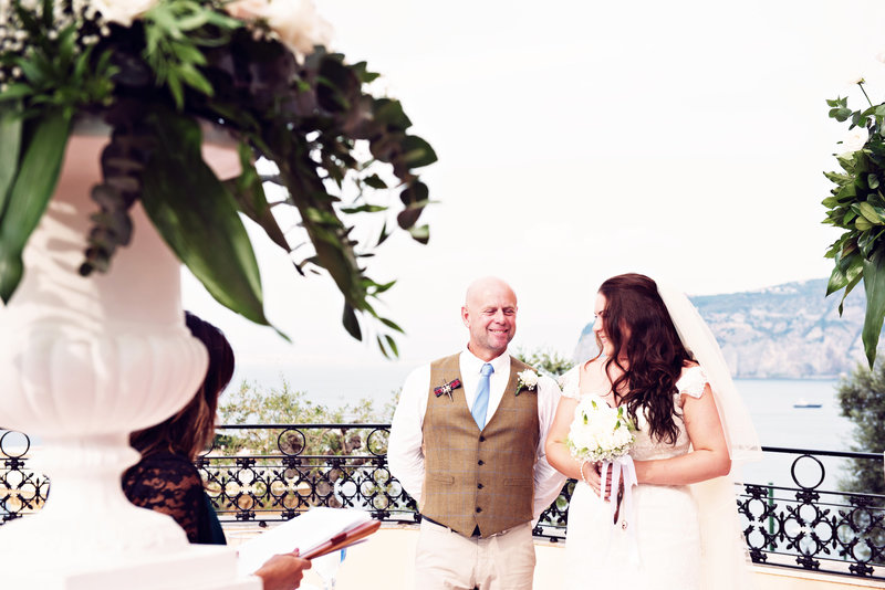 Bride and Groom on the balcony of the Grand Excelsior Vittoria Sorrento Italy during their ceremony