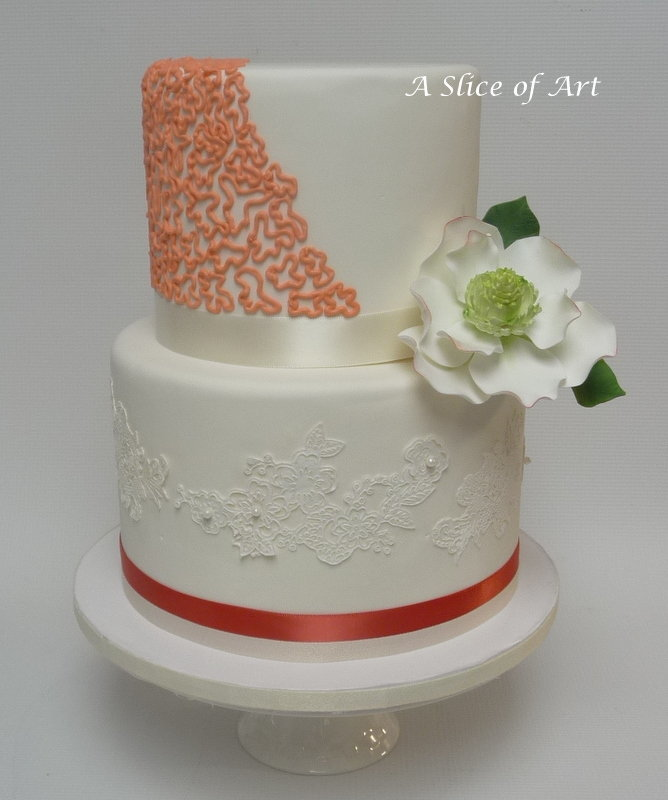 coral wedding cake with magnolia