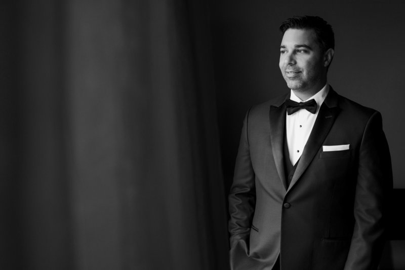 black and white groom  portrait in black tuxedo