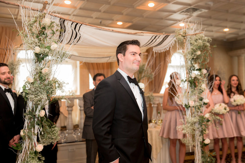 Groom seeing his bride walking down the aisle