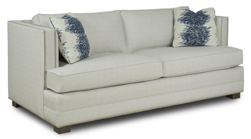 Square-shaped living room sofa with studded detail at Hockman Interiors