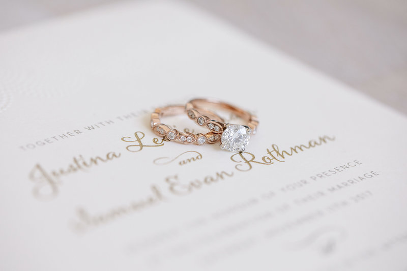 rose gold diamond wedding rings on invitation