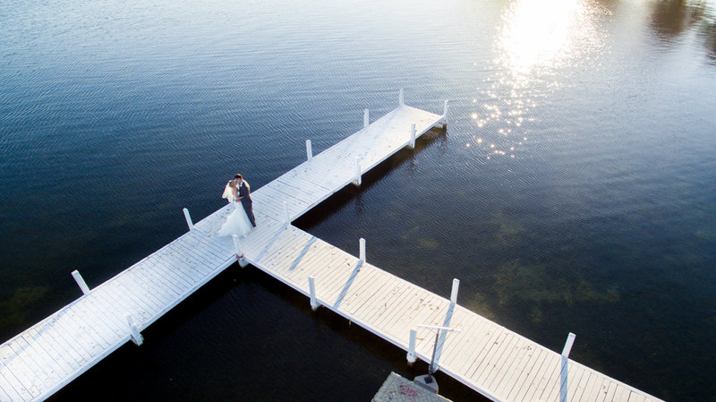 Drone photograph over pier at Lake Lawn Resort in WI. The drone photography adds a unique look to a wedding day and adds more to the overall images