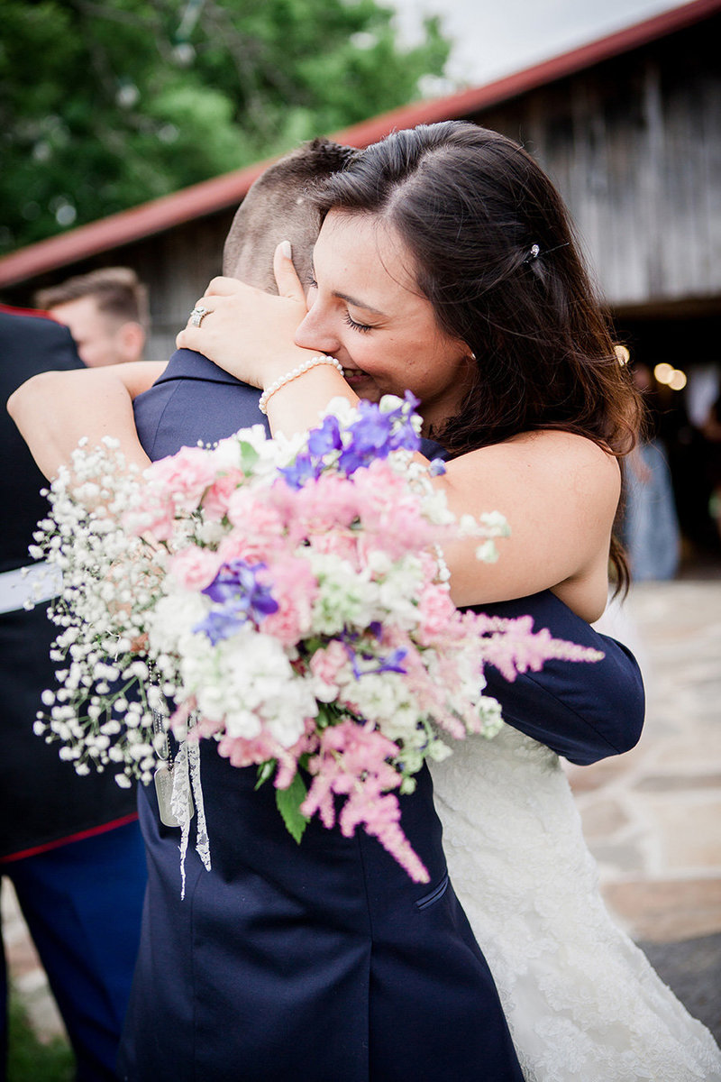Bride hugs her brother after the ceremony at The Barn at Highpoint Farms by Knoxville Wedding Photographer, Amanda May Photos.