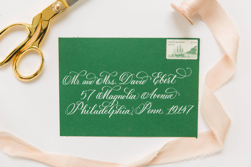 Green envelope with pointed pen calligraphy