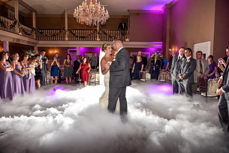 couple is dancing in a sea of clouds
