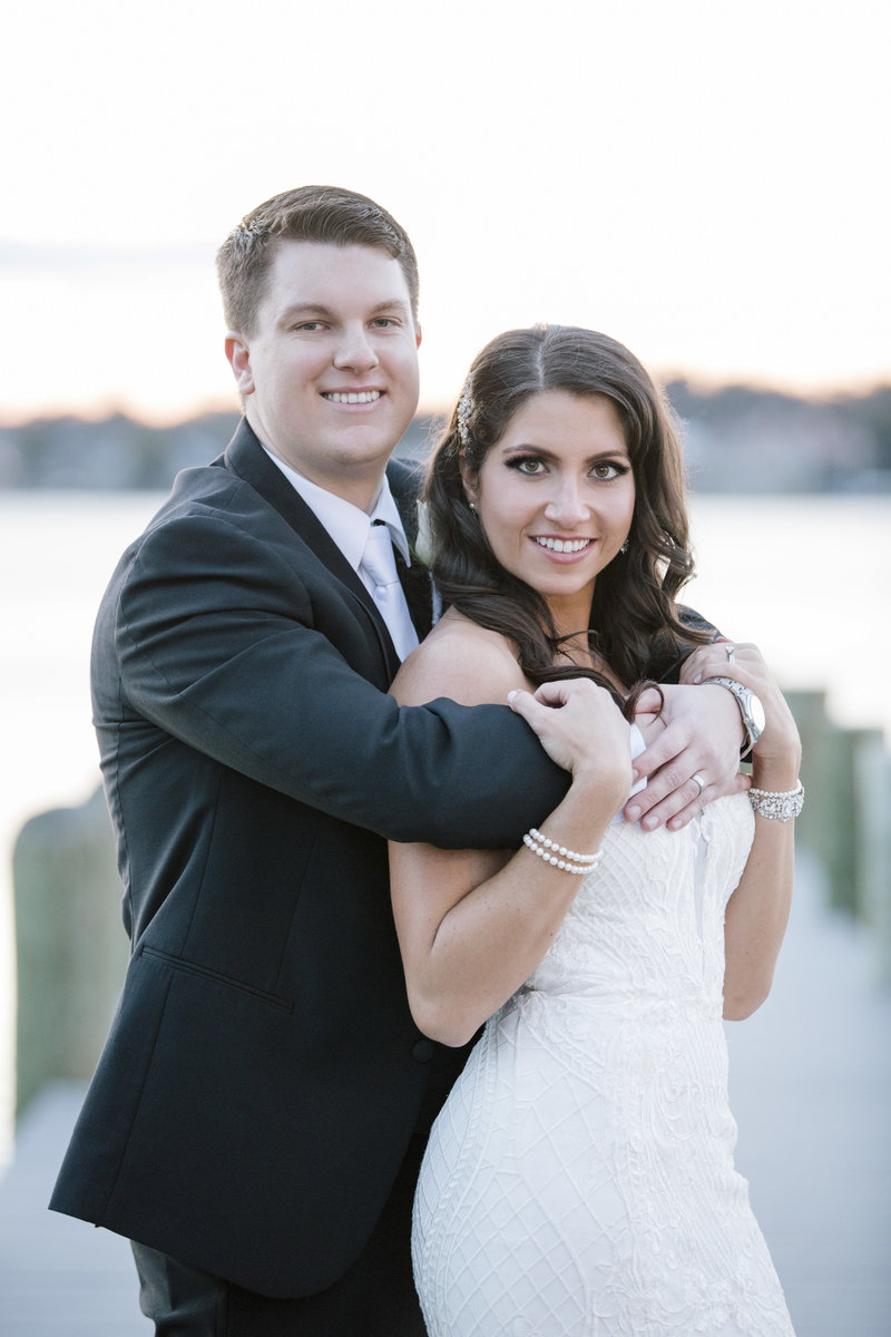 groom and bride portrait on dock in spring