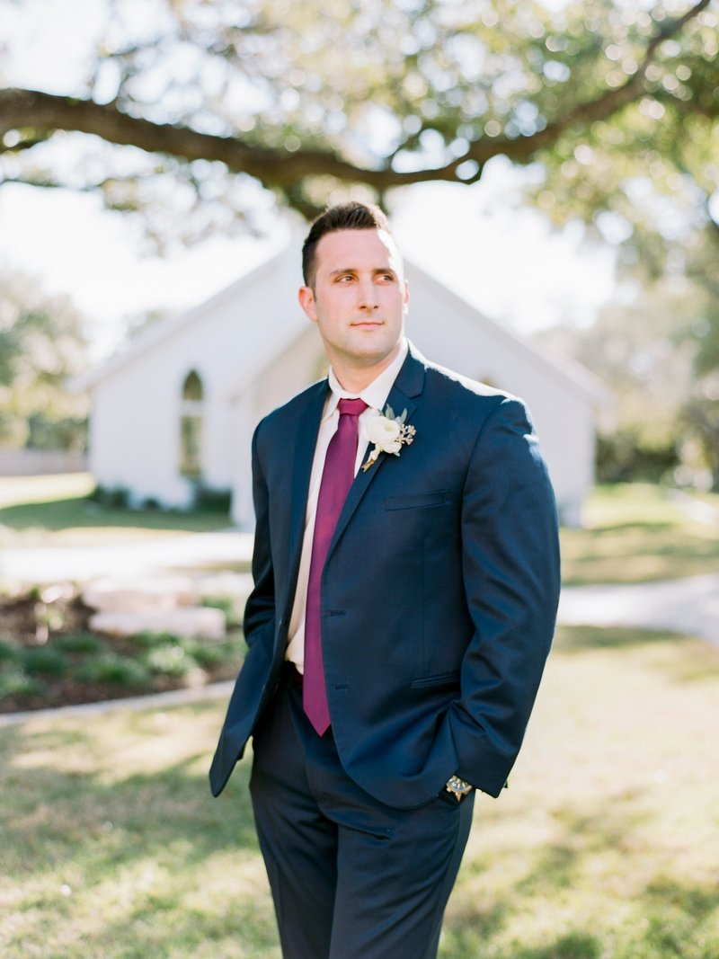 groom portrait in navy suit and burgundy tie