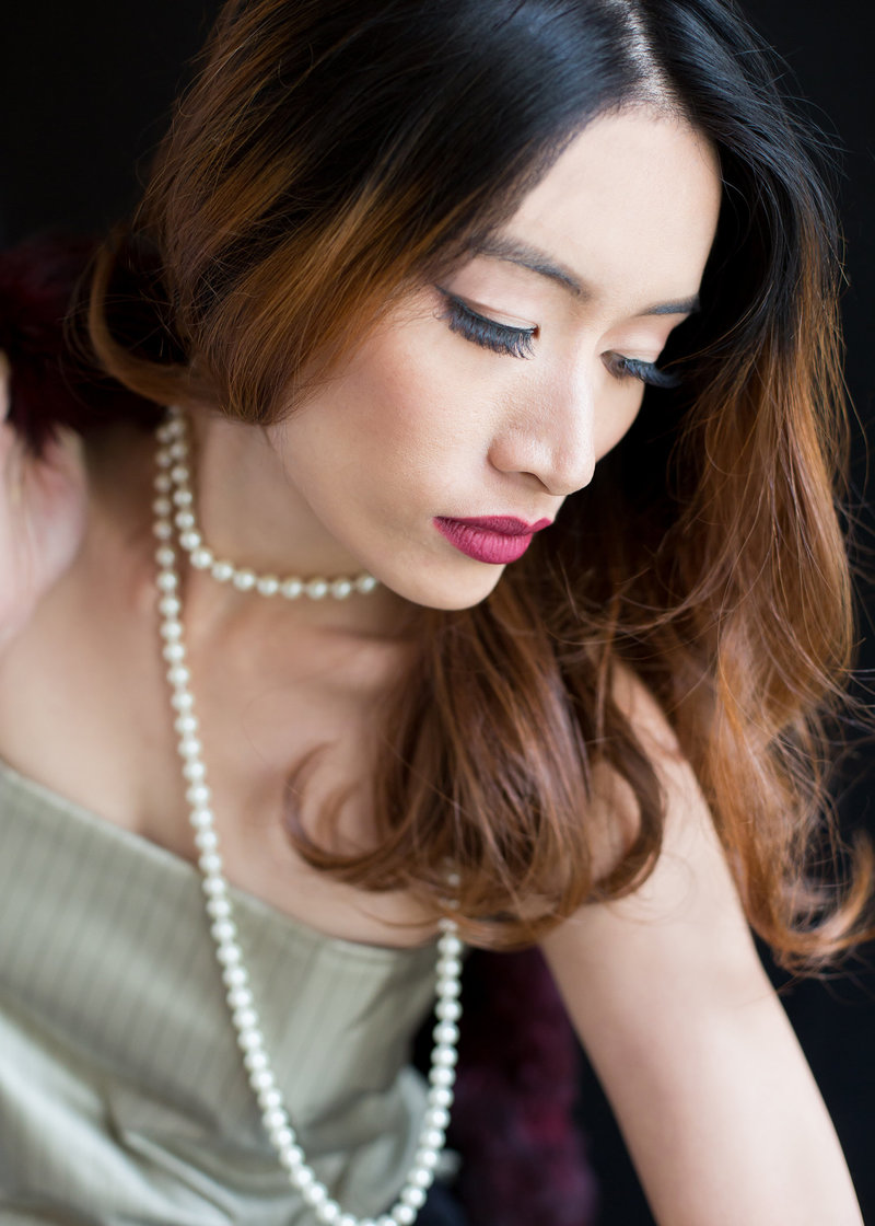 Portrait of an Asian woman wearing pearls