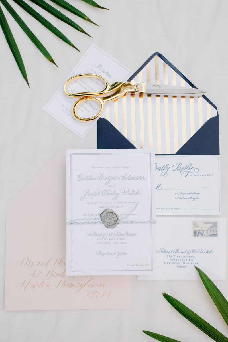Beautiful styled wedding invitations with gray ink and navy envelopes