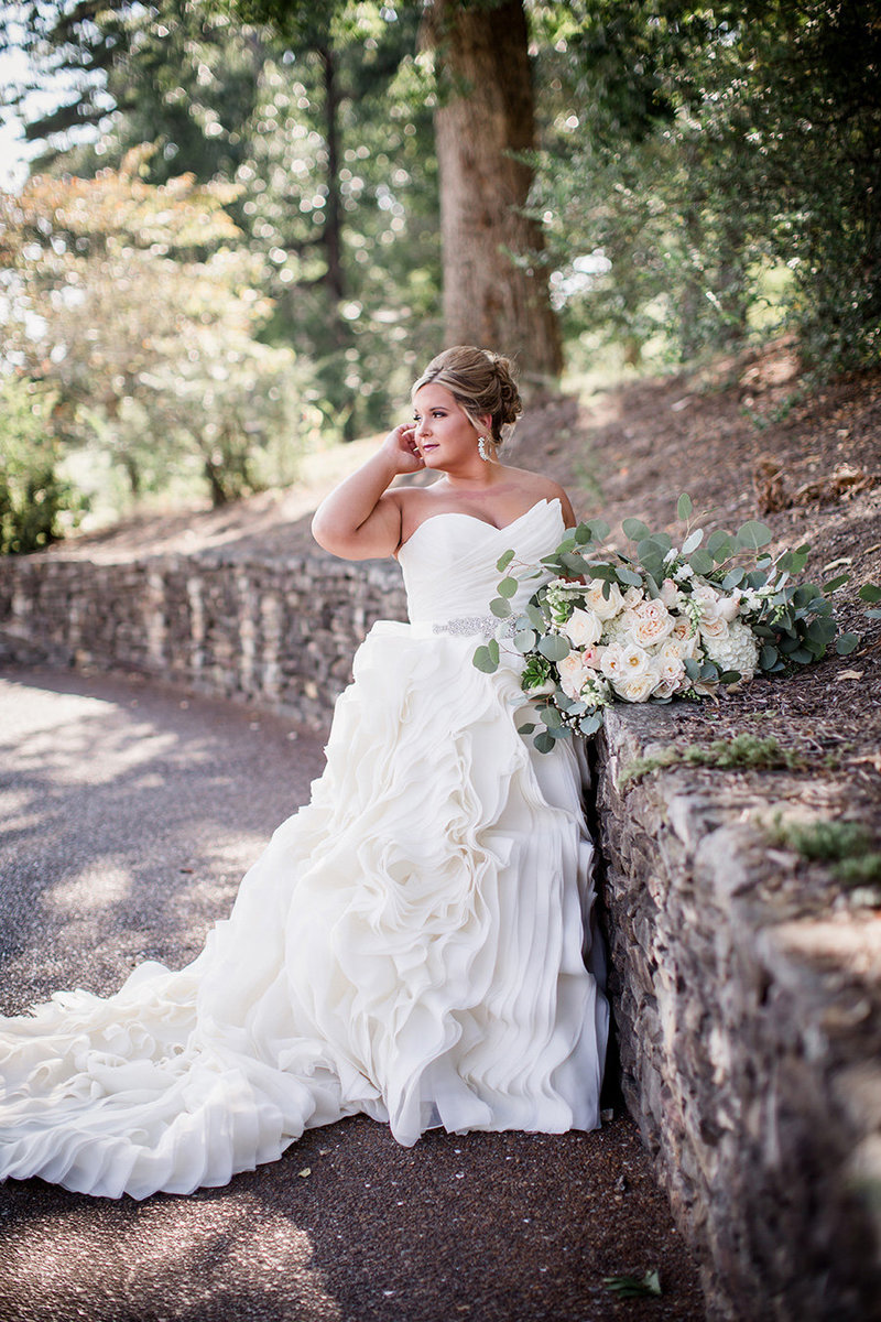 Bride looking back over her shoulder at Holston Hills Country Club Wedding Venue by Knoxville Wedding Photographer, Amanda May Photos.