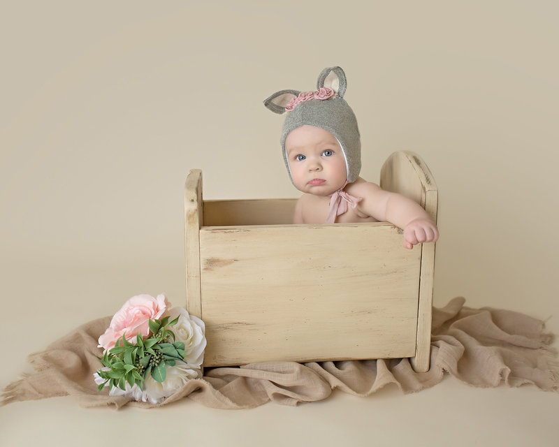 Little girl in crib fox ears photograpy
