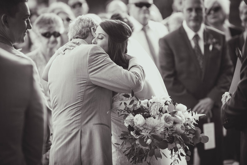 JandDstudio-colonial-golf-and-tennis-club-harrisburg-wedding-photography-blackandwhite-fatherofthebride-hug