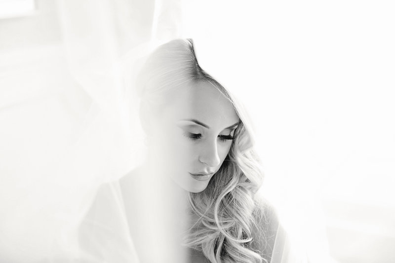 black and white  of bride under veil